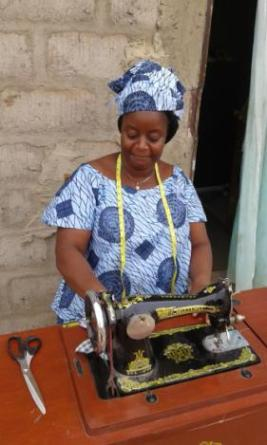 Esther Dama at her sewing machine